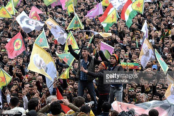 People wave Kurdish flags and pictures of jailed Kurdish rebel leader Abdullah Ocalan as they gather to celebrate Newroz the Kurdish New Year in the...