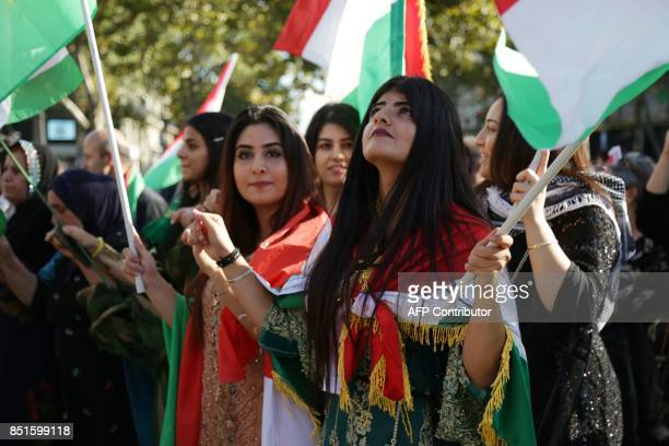 People wave Kurdish on September 22 on the Place de la Republique in Paris during a gathering in support of a 'yes' vote ahead of an independence...