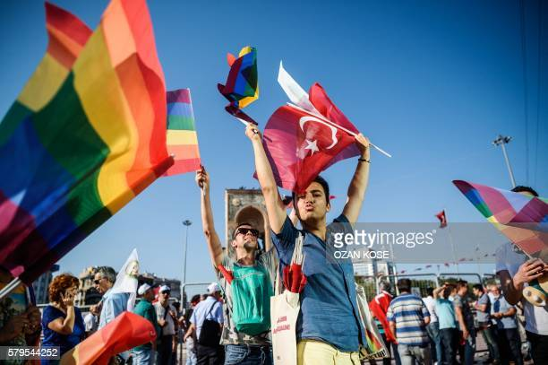 People wave LGBT rainbow flags at Istanbul's Taksim Square as they take part in a political demonstration on July 24, 2016. - Many thousands of...