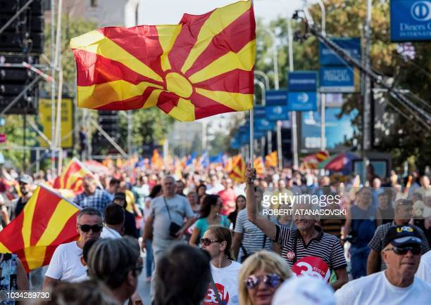 """People wave Macedonian flags as they attend a campaign rally for the """"yes"""" ahead of a referendum on wether to change the country's name to """"Republic..."""