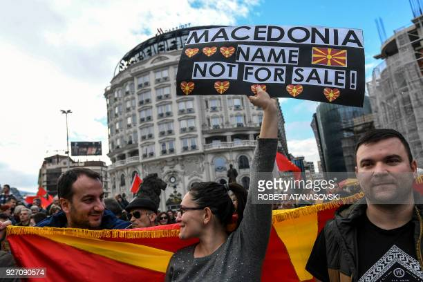 People wave Macedonian flags during a protest in a central square in Skopje on March 4 2018 Rightwing and diaspora organizations protested against a...