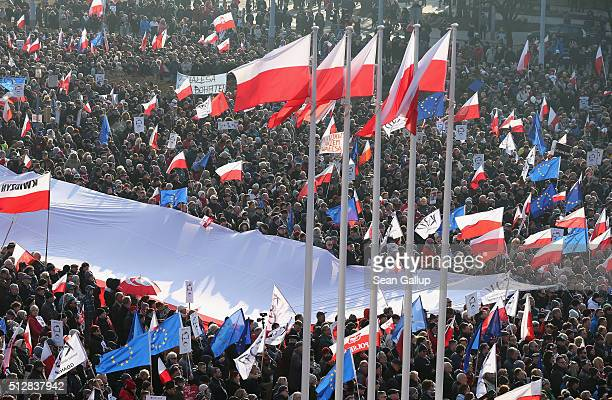 People wave Polish and European Union flags at a prodemocracy rally near the former Gdansk shipyards birthplace of the Solidarity movement that...
