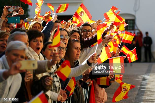People wave Spanish flags during the visit of King Felipe VI of Spain and Queen Letizia of Spain on February 06, 2020 in Ecija, Spain.