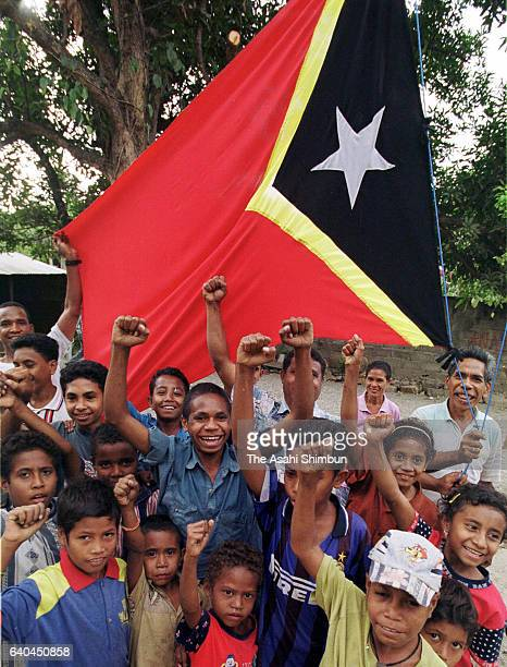 People wave the East Timor flag after the referendum vote on September 3, 1999 in Dili, Indonesia.