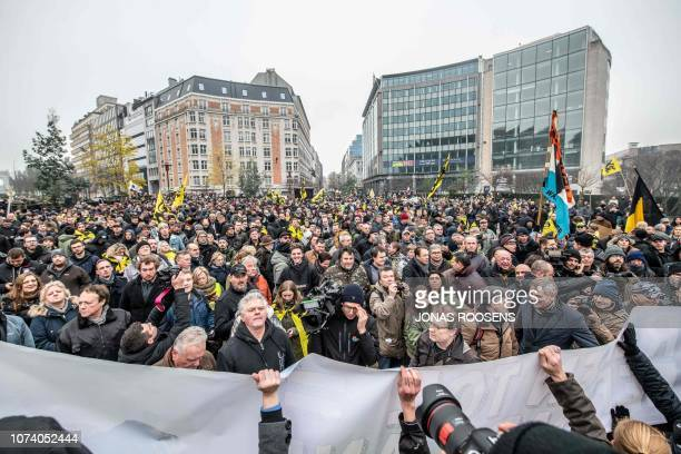 People wave the flag of the Flanders as they take part in a gathering called by the rightwing Flemish party Vlaams Belang and other organisations in...