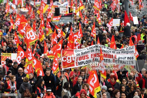 TOPSHOT People wave the flags of French trade union General Confederation of Labour as they take part in a demonstration to protest against the...