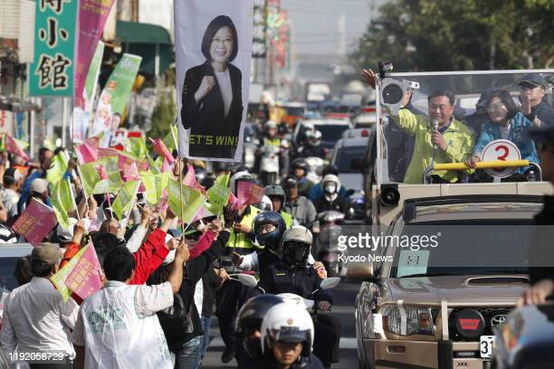 People wave to Taiwan President Tsai Ingwen of the Democratic Progressive Party in Kaohsiung southern Taiwan on Jan 6 ahead of the Jan 11...