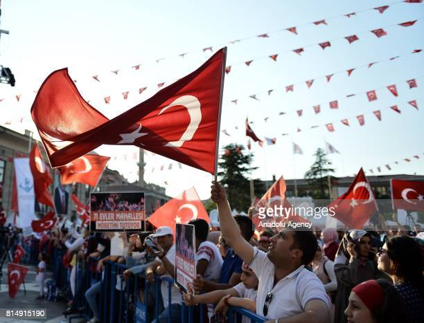 People wave Turkish flags as they attend July 15 Democracy and National Unity Day's events to mark July 15 defeated coup's 1st anniversary in...