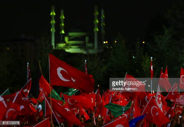 People wave Turkish flags as they attend July 15 Democracy and National Unity Day's events to mark July 15 defeated coup's 1st anniversary in front...