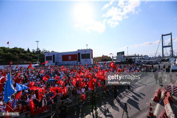 People wave Turkish flags during the July 15 Democracy and National Unity Day at 15 July Martyrs Bridge in Istanbul Turkey on July 15 2017 249 people...