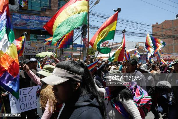 People wave whipala flags during the funeral ceremony for three men killed during clashes with police at the Senkata fuel plant on a during a funeral...