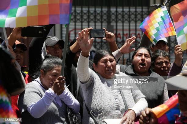 People wave whipala flags during the funeral ceremony for three men killed during clashes with police at the Senkata fuel plant on November 21 2019...