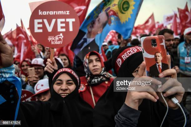 TOPSHOT People wave 'YES' banners and Turkish national flags on April 8 2017 during a Campaign rally for the 'yes' to a constitutional referendum in...