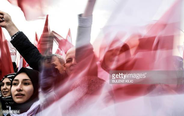 TOPSHOT People wave 'YES' banners and Turkish national flags on April 8 2017 during a campaign rally for the 'yes' vote in a constitutional...