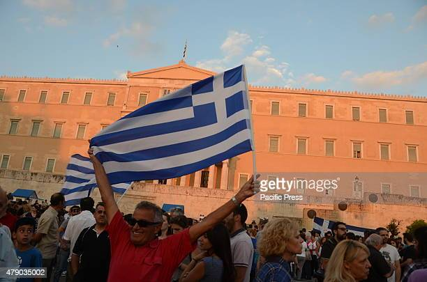 People waving flags at Syntagma square Greeks demonstrate in Syntagma square in support to a 'NO' vote in the referendum that will take place on the...