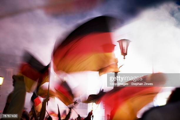 people waving german flags in fog - german flag stock pictures, royalty-free photos & images