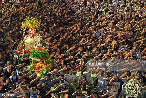 People waving hands during Sinulog mass at Santo Nino Basilica