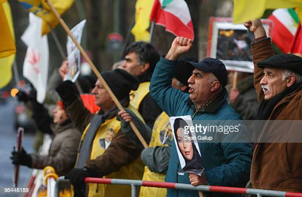 People waving prerevolutionary Iranian flags and a portrait of Iranoan opposition leaderinexile Maryam Rajavi protest against the recent government...