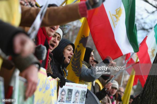 People waving pre-revolutionary Iranian flags protest against the recent government crackdown against anti-government demonstrators in Tehran outside...