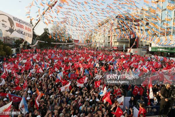 People wawe flags as President of Turkey and the leader of Turkey's ruling Justice and Development Party Recep Tayyip Erdogan addresses the crowd...