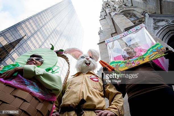 People wear costumes during the Easter Parade and Bonnet Festival along 5th Avenue March 27 2016 in New York City The parade is a New York tradition...