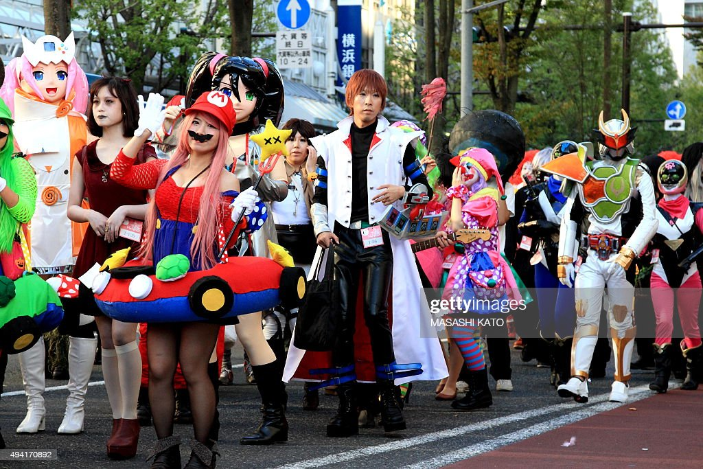 People Dress Up For Halloween Parade In Japan Photos and Images ...