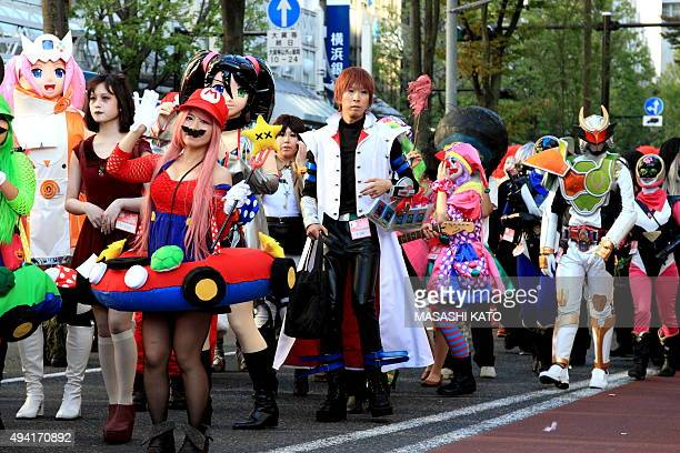 People wear costumes during the Halloween parade on October 25 2015 in Kawasaki Japan celebrating Halloween has become increasingly popular in Japan...