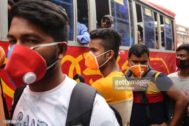 People wear face mask as they leave the capital city from Gulistan Bus Terminal because of the spread of the COVID19 Death toll raised to 4 and 39...