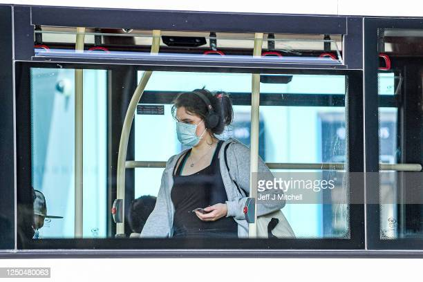 People wear face mask as they use buses in Princess Street on June 18, 2020 in Edinburgh, Scotland. First Minister Nicola Sturgeon announced phase 2...