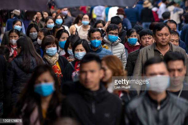People wear face mask while visiting a temple on the seventh day of Lunar New Year celebration on January 31, 2020 in Hanoi, Vietnam. Vietnam...