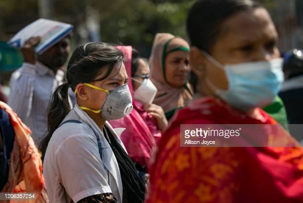People wear face masks amid fears of the spread the coronavirus on March 10, 2020 in Dhaka, Bangladesh. Three cases of coronavirus were detected in...