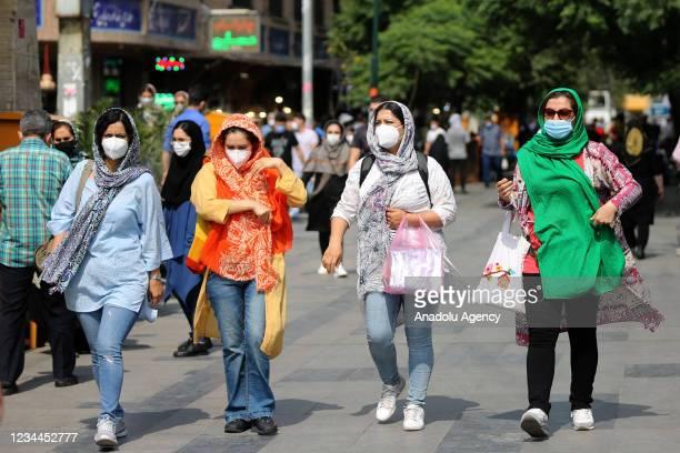 People wear face masks as a measure against coronavirus pandemic in their daily lives Grand Bazaar in Tehran, Iran on August 04, 2021. Coronavirus...