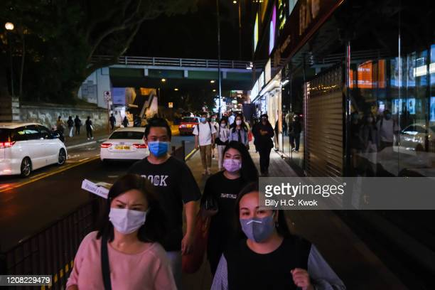 People wear face masks as a precaution against the spread of Coronavirus during a coronavirus outbreak on March 26 2020 in Hong Kong China Latest...