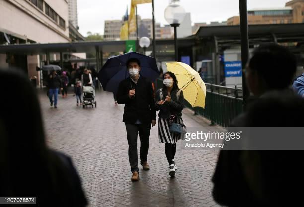 People wear face masks as a preventative measure against Coronavirus COVID19 in Circular Quay Sydney Australia on March 14 2020 Australia has...