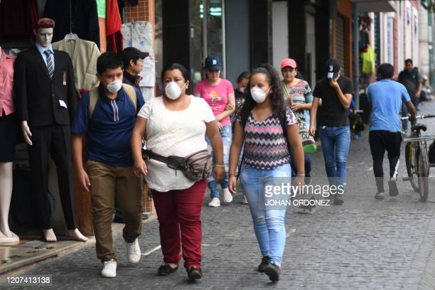 People wear face masks as a preventive measure against the spread of the new coronavirus COVID19 in Guatemala City on March 16 2020 Guatemala's...
