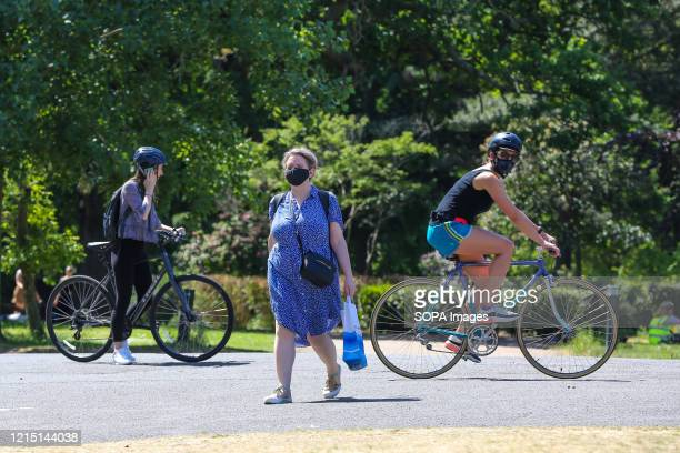 People wear face masks as a preventive measure in London on a very hot and sunny day The UK government has started to ease the coronavirus lockdown...
