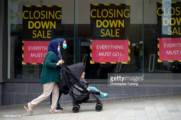 People wear face masks as they go about their daily lives Oldham on July 29 2020 in Oldham England Oldham Council is taking preventative measures to...