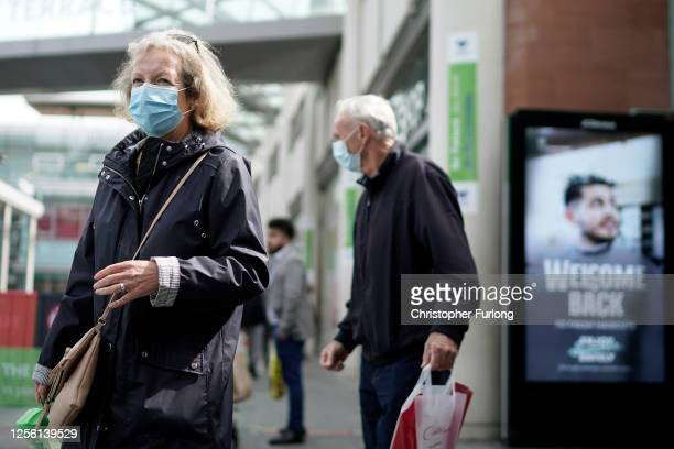 People wear face masks as they shop on July 14, 2020 in Liverpool, United Kingdom. The UK government has announced that people entering shops will be...
