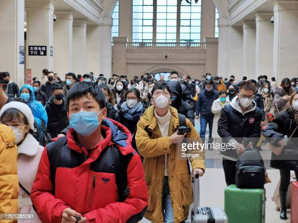 "People wear face masks as they wait at Hankou Railway Station on January 22, 2020 in Wuhan, China. A new infectious coronavirus known as ""2019-nCoV""..."