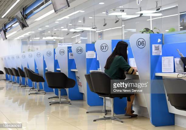 People wear face masks at the UK Visa Application Service Center on July 3, 2020 in Beijing, China.