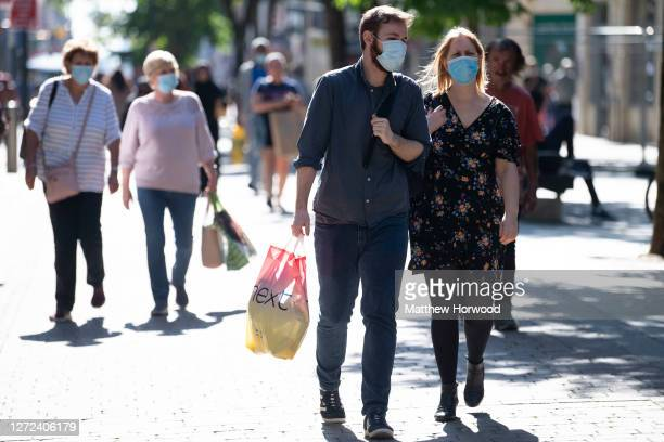 People wear face masks in the town centre on September 14, 2020 in Newport, Wales. First Minister of Wales Mark Drakeford has announced people in...