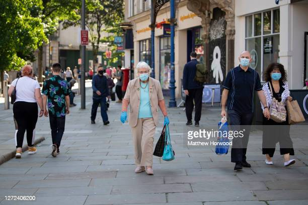 People wear face masks in the town centre on September 14 2020 in Newport Wales First Minister of Wales Mark Drakeford has announced people in Wales...
