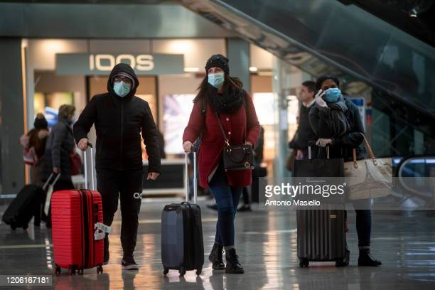 People wear face masks wait at the Termini Central Station during the Coronavirus emergency, on March 9, 2020 in Rome, Italy. Italian Prime Minister...