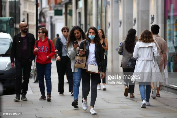 People wear face masks while shopping at Covent Garden on July 4, 2021 in London, England. Robert Jenrick, British minister for housing communities...