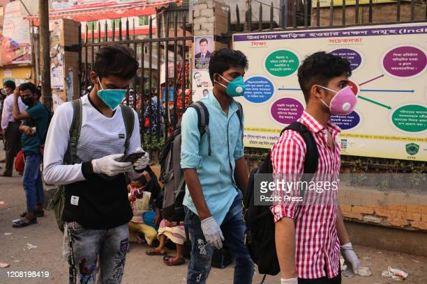 People wear facemask as they leave the capital city from Gulistan Bus Terminal because of the spread of COVID19 Death toll raised to 4 and 39 people...
