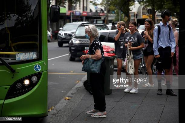 People wear facemasks on public transport in Auckland on January 28, 2021 in Auckland, New Zealand. Auckland residents are being urged to remain...