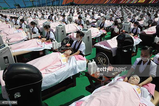 People wear facial masks for the sake of beauty on May 4 2015 in Jinan Shandong province of China A thousand people wore facial masks at the same...