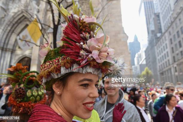 People wear fanciful hats during the Easter Parade and Bonnet Festival along 5th Avenue on April 16 2017 in New York City The pageant is an annual...