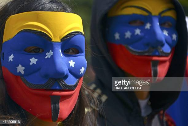 People wear Guy Fawkes masks during a protest against the government of Venezuelan President Nicolas Maduro in Caracas on February 22 2014 Tens of...