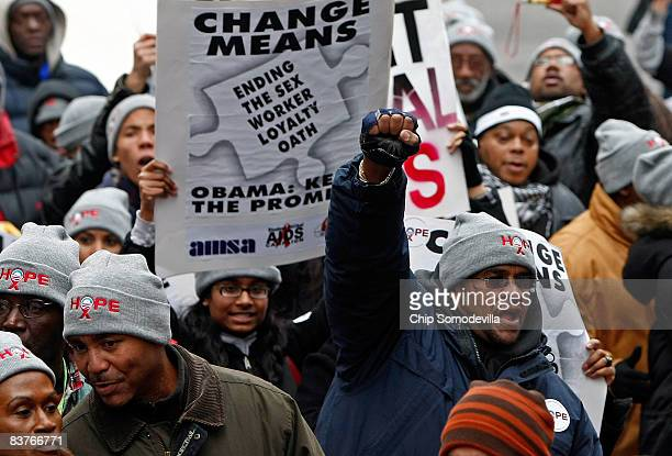 People wear hats inscribed with the word hope with the Barack Obama presidential campaign's trademark logo of the rising sun as about 1000 people...